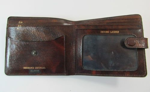 VINTAGE BROWN LEATHER BIFOLD WALLET PURSE R11263 For more pictures of the same please visit any of my blogs: Tumblr  link   http://sangriasuzie.tumblr.com/ Wordpress blog link  http://sangriasuzie.org/ http://stores.ebay.co.uk/Sangriasuzies-Emporium http://www.sangriasuzie.com/ If any of the  items pictured in this blog/pin take your fancy they can be bought from one of the above addresses.  Or e-mail me at drobertshq@hotmail.com   if you need more info.
