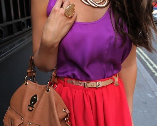 Gold belt with neon purple tank and red skirt