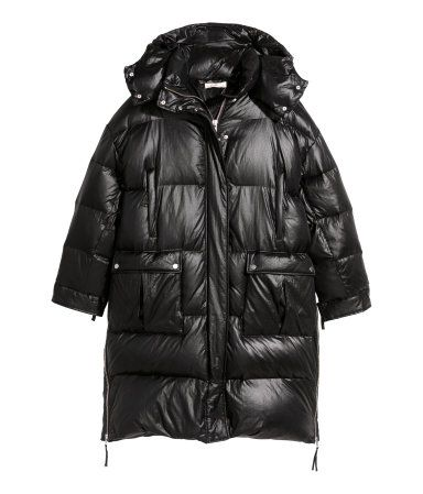 Black. Long, padded jacket with a sheen. Detachable padded hood, stand-up collar, and zip and wind flap at front with snap fasteners. Handwarmer pockets