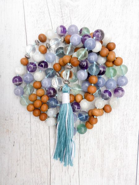 The Free Spirit Mala has a soothing, positive energy that awakens ones mind to the collective mind of the universe. It enhances balance and emotional stability,