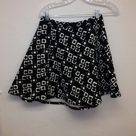 Bought from Nordstrom Goes down to mid thigh and is very soft. Soprano Skirts Midi
