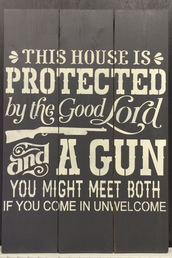 """Indoor planked wooden pine sign:  THIS HOUSE IS PROTECTED BY THE GOOD LORD AND A GUN YOU MIGHT MEET BOTH IF YOU COME IN UNWELCOMED. 16.5""""x24"""" $44.99"""