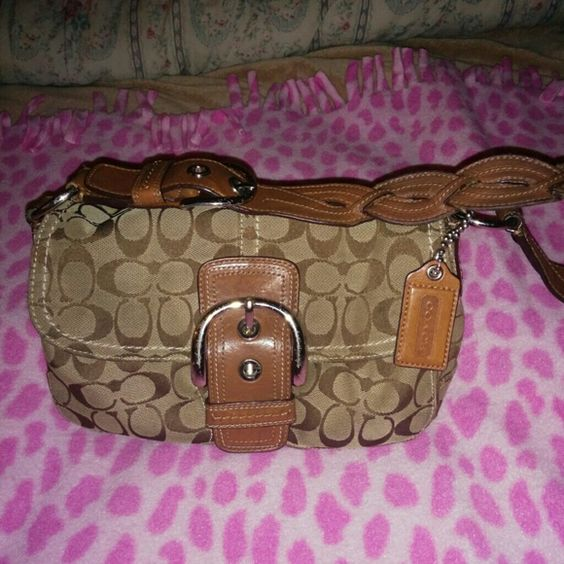 ***Reduced***Pre-loved Coach bag Tan/brown Authentic Coach bag w/ cute buckle front closure and buckle in side of braided strap...needs some cleaning and on inside from make up marks Coach Bags