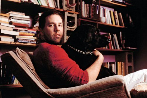 "DFW, dog, books - Great image.  (Links to excerpt from D.T. Max's biography about David Foster Wallace, ""Every Love Story is a Ghost Story."")"