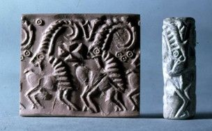Proto Elamite, Jedmet Nasr, 3100BC-3000BC. Streaked pale yellow-brown steatite or calcite cylinder seal with blue-grey patches; two goats; in field - 'Maltese' cross, circled dots.