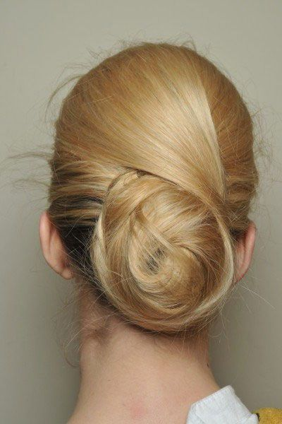 Make a big bun without the top layer of hair, then criss-cross the top layer around the bun and pin