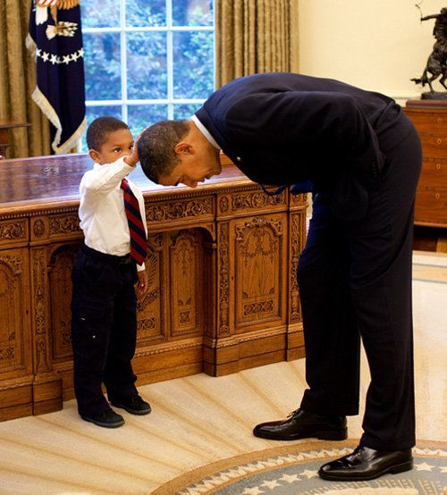 Recent photo of a little boy visiting the White House.  He wanted to feel President Obama's hair because he wanted to know if the President's hair felt just like his. President Obama obliged.  Priceless.