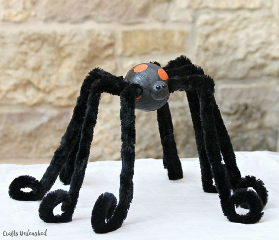 Get started on your Halloween decorating with this fun large spider craft decoration. It's simple to make and is perfectly creepy for guarding a candy bowl!