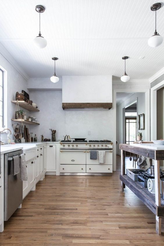 Kitchen design ideas from a beautiful white modern farmhouse kitchen with rustic decor by Beth Kirby of Local Milk. Stunning Lacanche Sully range plays a starring role! #kitchendesign #kitchendecor #modernfarmhouse #lacanche #bethkirby #rusticdecor #farmhousekitchen