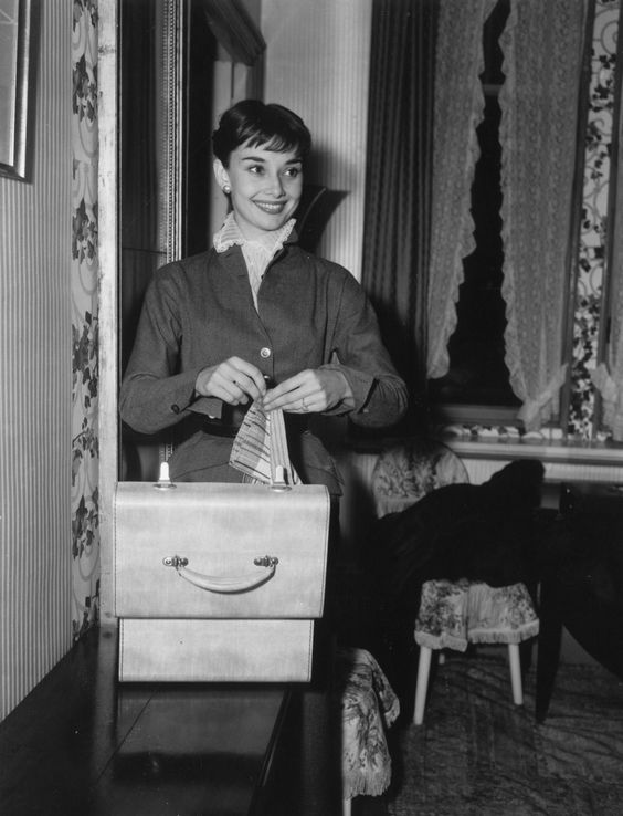 The actress Audrey Hepburn photographed by L. Waldorf in her room at a hotel in Rome (Italy), on October 01, 1952. Audrey was wearing: Suit: Sorelle Fontana (of fine wool, for the day-to-day, of the collection for the Spring of 1952).