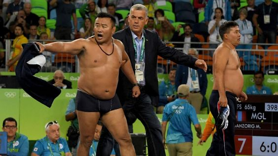 Mongolian wrestling coaches strip off clothing in protest of call