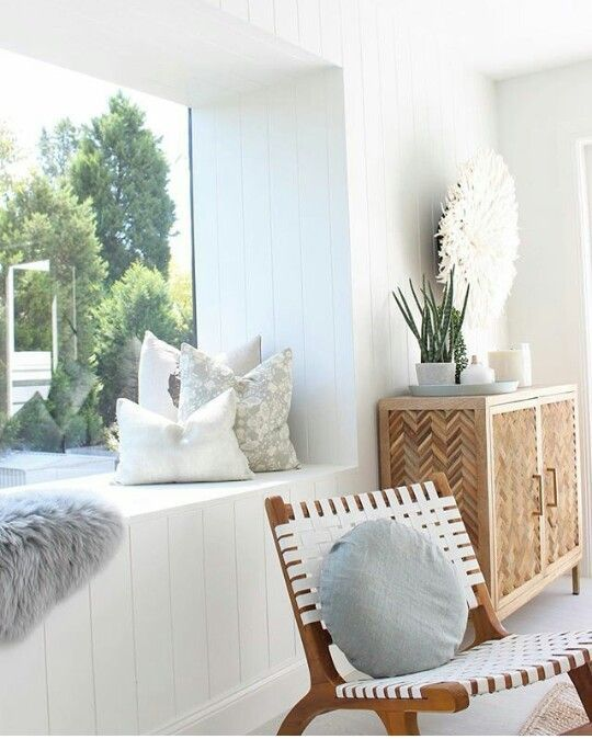 White and timber. Large picture window. Calm space.