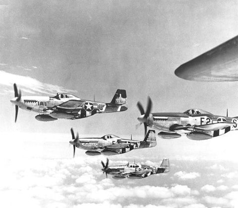 A flight of P-51 Mustang aircraft, possibly over Europe, 6 Jun-9 Aug 1944