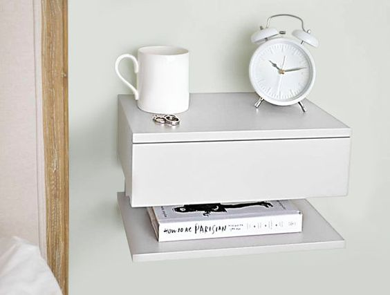 Solid beech bedside table. Attaches to the wall to maximise space use in small bedrooms. One drawer and one shelf. Perfect to fit a lamp, book