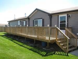 mobile home deck designs. A large and long deck for a mobile home  Mobile front porch with wood gabled roof handrail