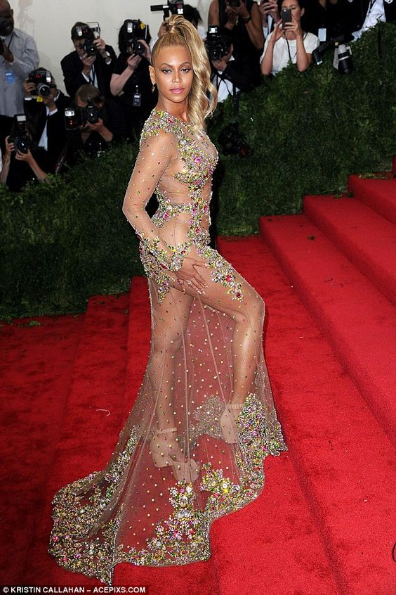 Stealing the show: Beyonce made a stunning arrival at Monday's Met Gala in a bold nude-effect gown