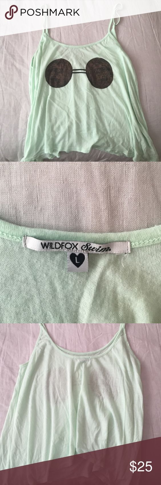 Wild fox Swimsuit Cover-Up Cotton and polyester blend tank top for over a swim suit or with a bandeau and some cute cut off shorts! It's from the wildfox swim line and I have only worn it maybe 3 times. No holes, no pulling, LIKE NEW condition. Wildfox Swim Coverups