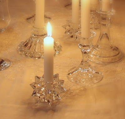 Mismatched crystal candlesticks make a beautiful centerpiece