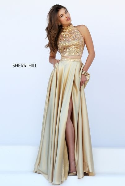 Glamorous gold two-piece prom dress red carpet look Sherri Hill prom dress available at Hope's Bridal