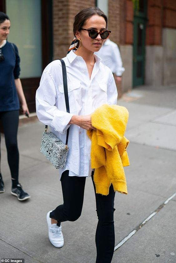 Alicia Vikander keeps things casual in an oversized white shirt   Daily Mail Online