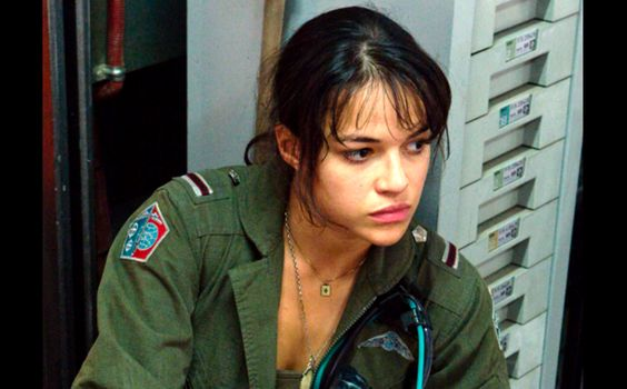Michelle Rodriguez  AVATAR takes us to a spectacular new world beyond our imagination, where a reluctant hero embarks on a journey of redemption, discovery and unexpected love, as he leads a heroic battle to save a civilization.