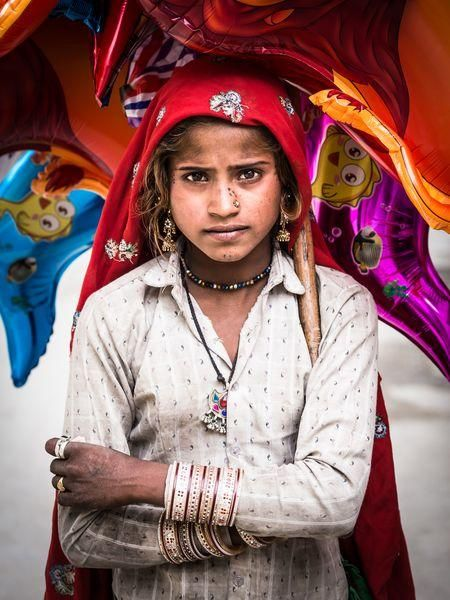 Girl of baloons Photo by Marco Tagliarino - 2015 National Geographic Photo Contest