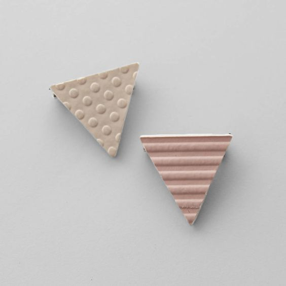 Cute handmade triangle brooch.Design options: Pink - Horizontal stripe pattern Tan - Dot patternThe triangle brooch is handmade from textured wall-covering and vinyl. A piece of wall-covering is backed with vinyl to give the piece strength and is attached to a silver tone tie pin. The back of the piece is black. Perfect for any outfit or even to add fun to a bag. The wall-covering used to make this brooch is up-cycled from interior decorating samples.Top: Wall-covering (PVC). Back: Vinyl…