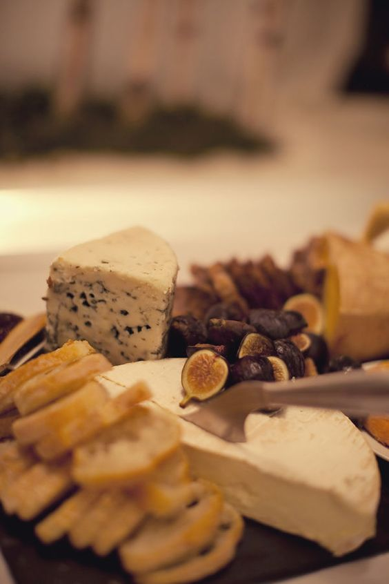 platters with artisan cheeses, toasts, dried fruit, nuts and figs