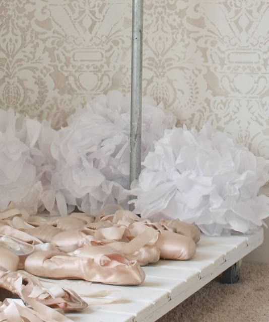 Pink pointe shoes on DIY industrial garment rack/ballet slippers/white tissue poufs/white and grey stenciled wall/Fortuny stencil/Hello Lovely Studio