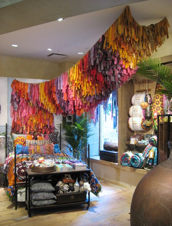 fabric installation at anthropology by Trilby Nelson- various materials on burlap netting: