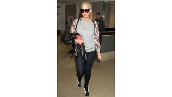 Out and About: Everything Is Coming Up Roses Amber Rose strolls through LAX airport in sneakers, jeans and a sweatshirt with rose buds on the sleeves.