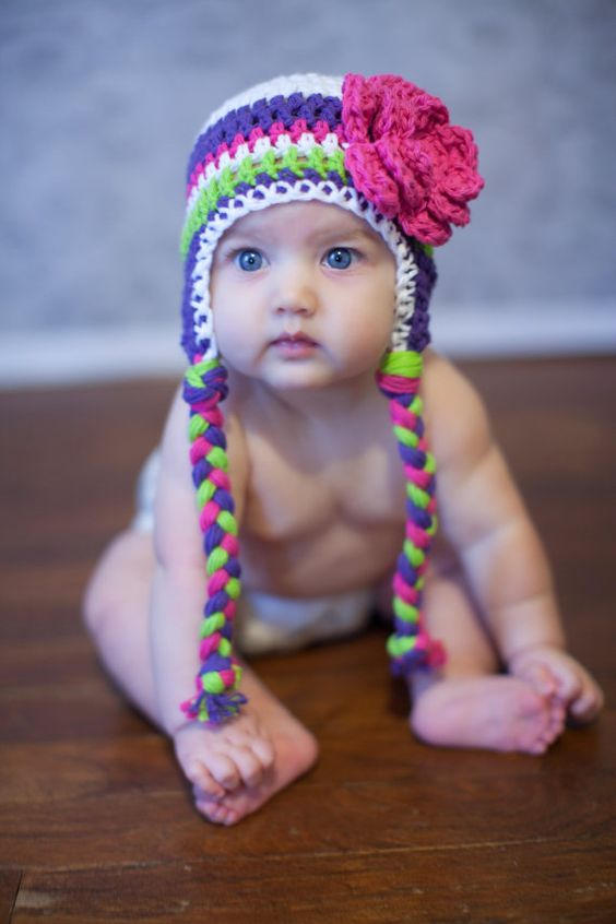 Love the colors....striking with the blue eyes!  Possibly the next hat to crochet for my daughter!!!!: