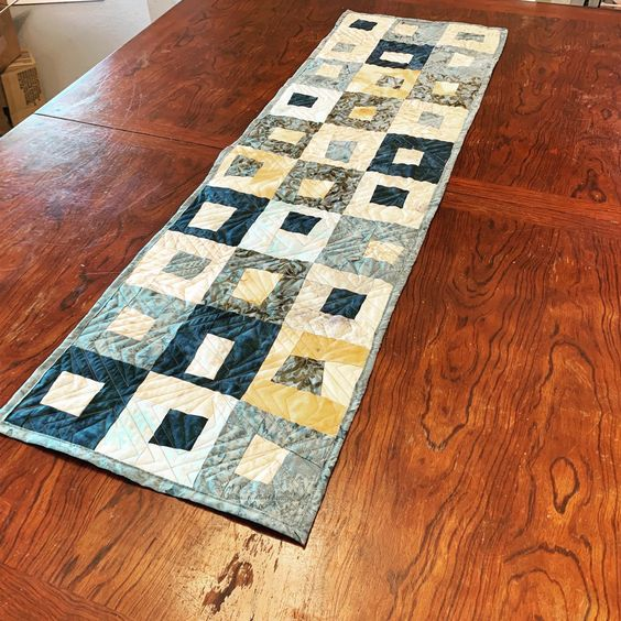 Wanteda table runner for my dining room. Love my rusted fabrics with these blue fabrics. I think the diamond quilting really makes the whole quilt pop.