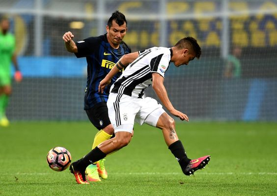 (L-R) Gary Medel of FC Internazionale competes for the ball with Paulo Dybala of…