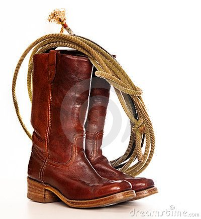 Brown cowboy boots and a Lasso by Phartisan, via Dreamstime