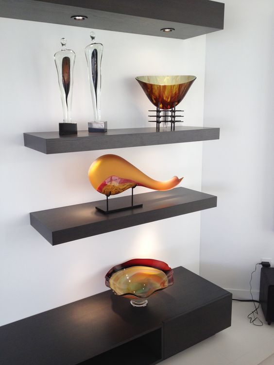 Beautiful display of our customer's collection of art glass. The Yellow Gold Montara on a metal stand by Bernard Katz Glass.