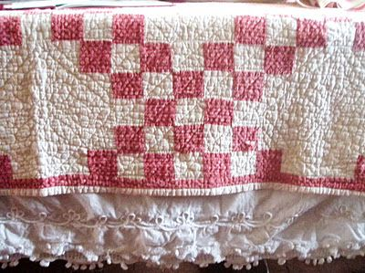 love the red checked vintage quilt with the ruffled lace underneath