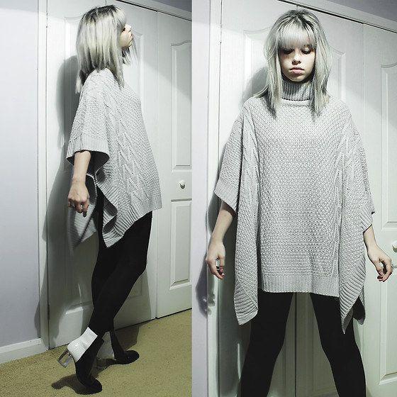 Quer uma verdadeira muralha contra o frio? É só usar um blusão comprido. | 12 truques para se vestir no inverno sem parecer um urso