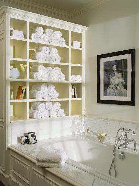 Built in shelving for towels, soaps and books behind tub.  Love this idea! Much better use of space than the single towel bar we have there now.