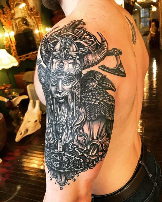 Cloaked Norse God Wielding an Axe tattoo