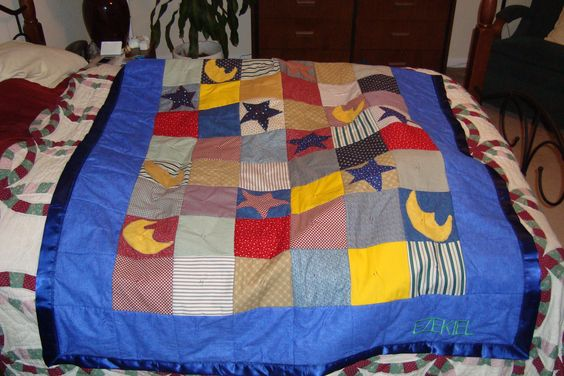 A quilt I helped finish off for a friend's grandson.   I added his name in embroidery so he could tell it from his brothers' quilts :)