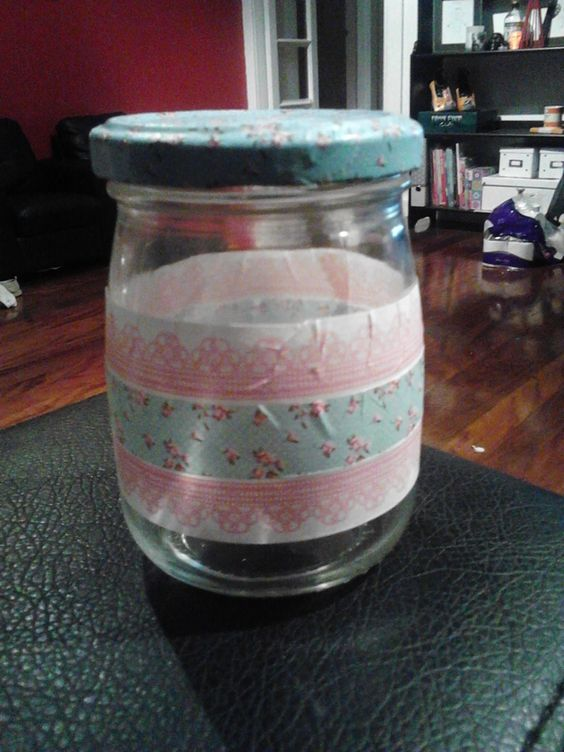 Washi tape old pesto jar. Great for keeping my washi tape in!