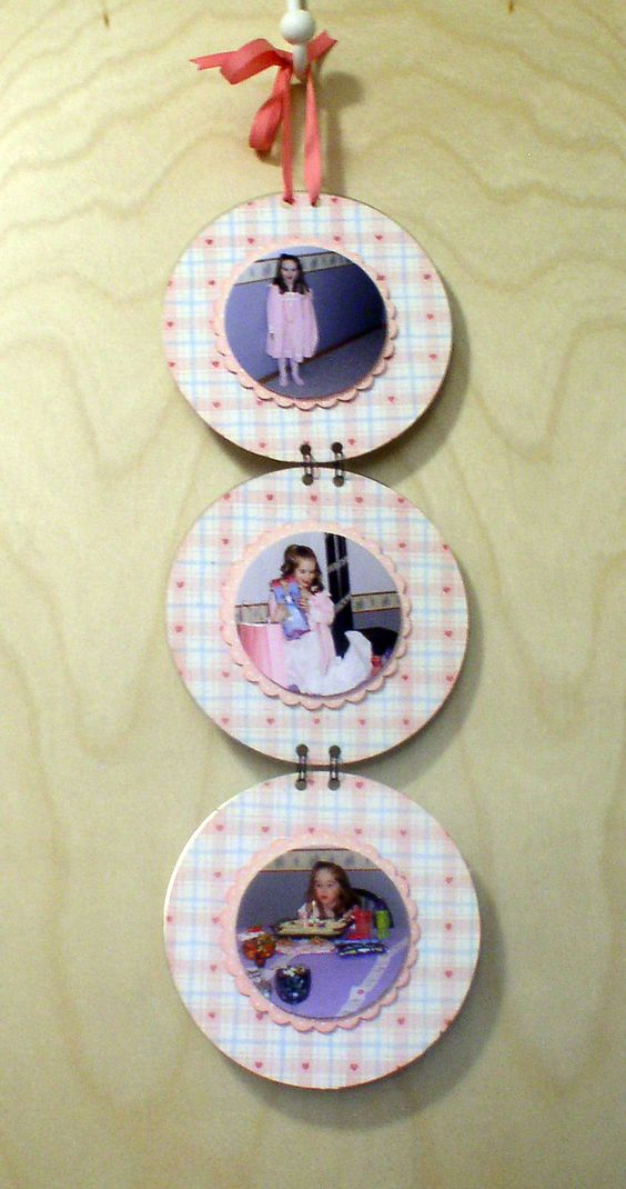 Old CDs with scrapbook paper and photos. Holes made with a Crop-A-Dile and attached with Bind-It-All: