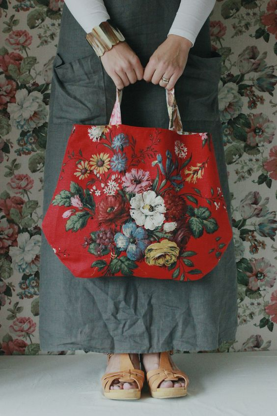 Meet Lara..she is a rather pretty handy-bag made from a rare vintage floral Sanderson print.  She likes to be taken out for a shopping spree and she likes to think she is not only a bag but a rather pretty accessory to your daily wear.  When not in use she likes to be hung on a wall so all can share in her beauty.She is approx 48cm wide.PLEASE NOTE: the images show her as a slightly brighter red than she actually is - she is more Chanel than TomatoLara will arrive wrappe...