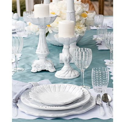 Gorgeous sea blue linens against cloud white china and sea urchin glassware.