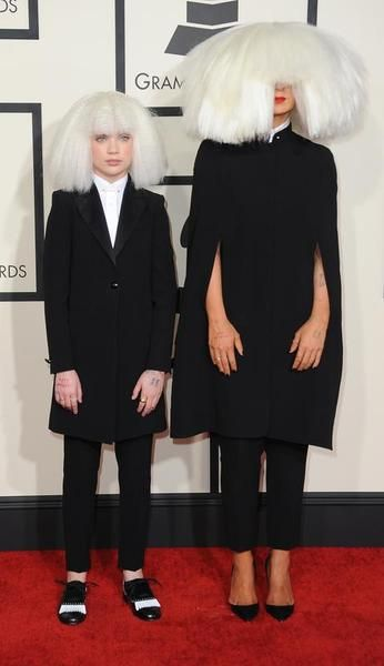 Nominee for Record Of The Year Sia arrives with Maddie Ziegler on the red carpet for the 57th Annual Grammy Awards