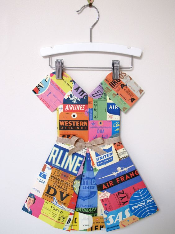 """Stunning folded paper """"dress"""" by Marcelle Crosby. Would look amazing hanging in a cool girl's room or nursery."""