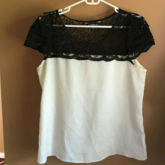 Beautiful Express Lace-Detailed Blouse White blouse, with black lace detail on the top. Worn one time - perfect condition! Body is 100% polyester. Lovely and perfect for work or dressy occasions. Express Tops Blouses
