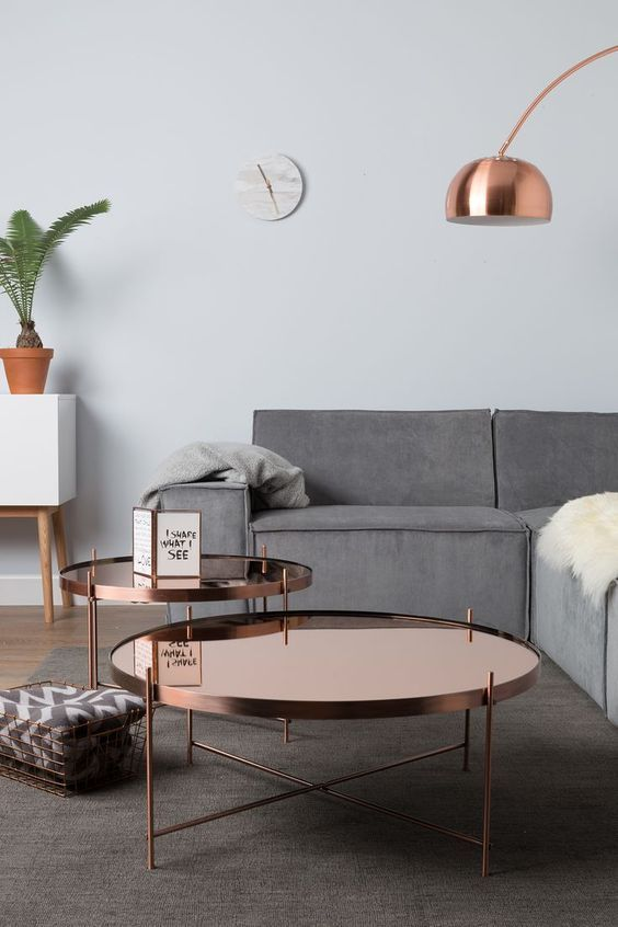 Stylish monochrome living room inspiration with greenery and wood accents. We love the copper coffee tables. #modernliving #contemporarylivingroom