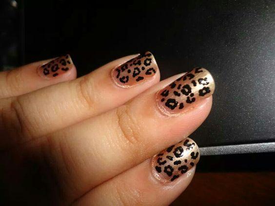 Animal print nail art. Spots formed with random dots using black nailart pen.